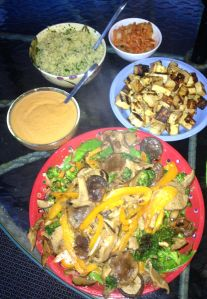 Clockwise from top left: Cilantro and lime quinoa, Trader Joe's kimchi, grilled tofu, grilled veggies, and Thai peanut sauce. Mixing the cuisine from several countries, but I don't claim to be an Asian food purist