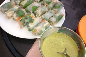 Vietnamese spring rolls with a cilantro peanut dipping sauce.