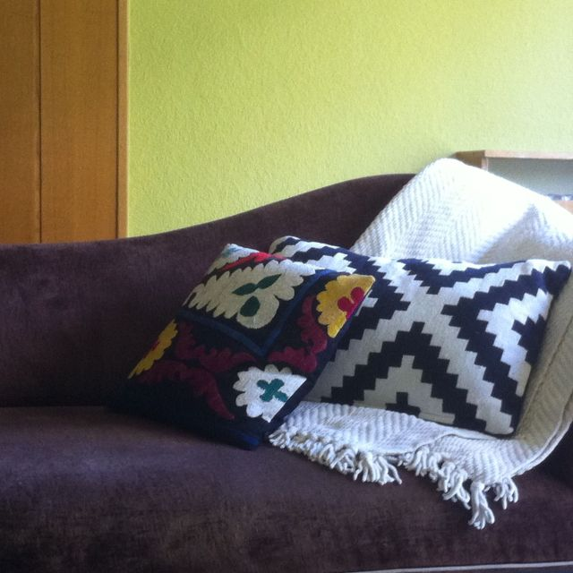 An Ikea pillow getting cozy with one from the Grand Bazaar in Istanbul. On a brown chaise that I scored for just $200 at a now-defunct Washington DC furniture store.