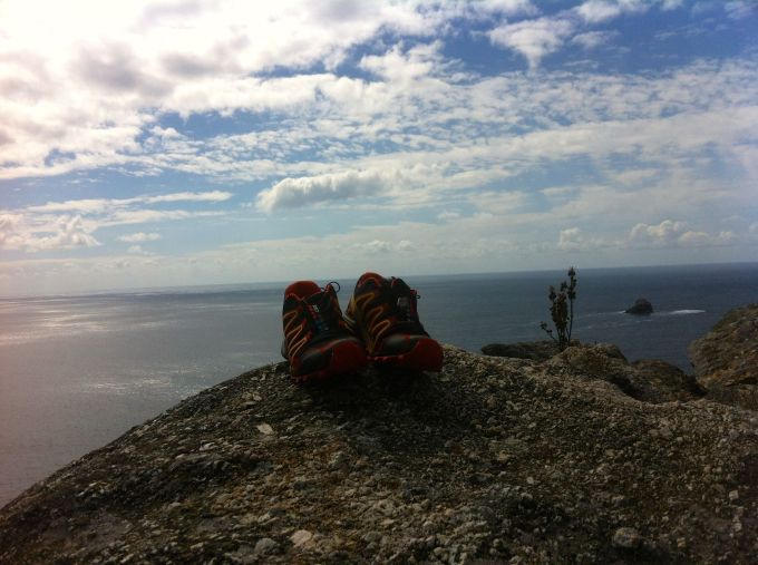 A hiker on the Camino de Santiago left behind his worn-out shoes. Lucky shoes to enjoy this view.