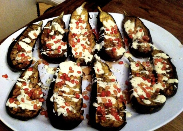Roasted Eggplant with Buttermilk Sauce and Pomegranate Seeds.