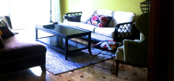 Former coffee table: Black, visually heavy and a cathair magnet.