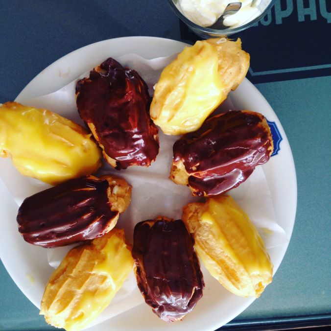 Lemon and chocolate whipped cream filled eclairs at Leitaria da Qta do Paco.